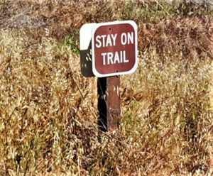 """Stay on trail"" sign"