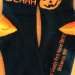 "Black and Orange Halloween-themed 1998 hash socks with Pumpkin saying ""On On"""