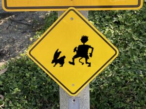 Yellow Hash Boy chasing Hare Traffic Sign
