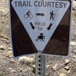 Hash Boy Trail Courtesy Sign indicating Bicyclists and Hikers are required to yield the trail to Hash Boy.